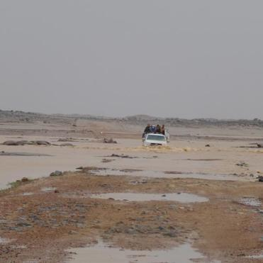 Crossing the desert with our car half-immersed in water.