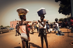 Girls selling cold drinks